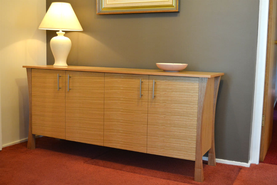 Tassie Oak Sideboard. Can be made with draws, doors or a combination of both. Made with clean and contemporary look with its curved legs and straight line it will made a fine addition to any room. Custom made timber furniture. Custom made furniture and furniture maker.