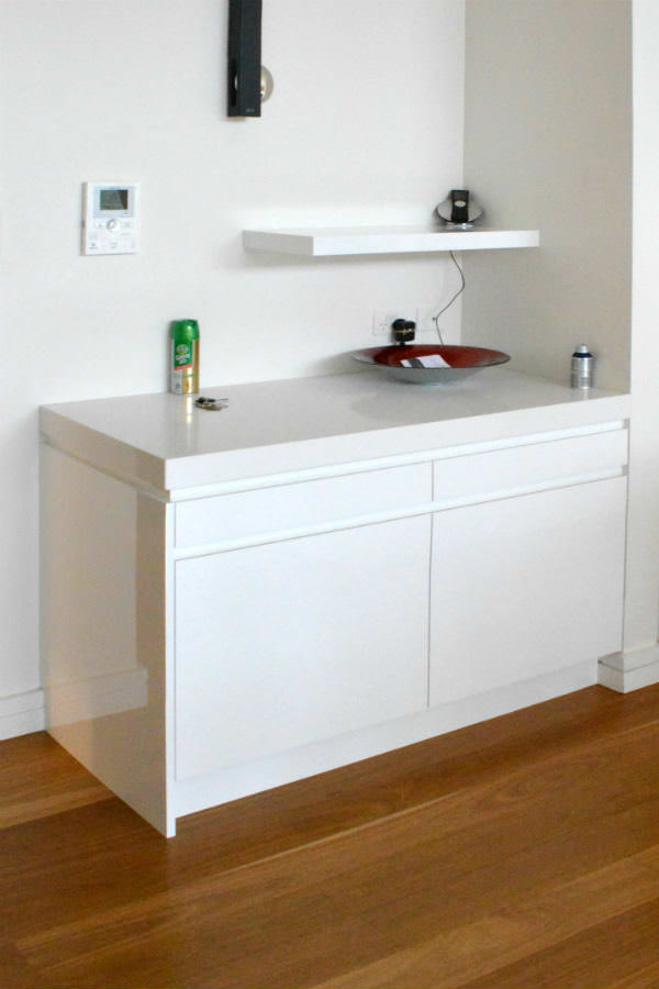 Free floating shelf and kitchen cabinet. Custom made joinery and cabinet making.