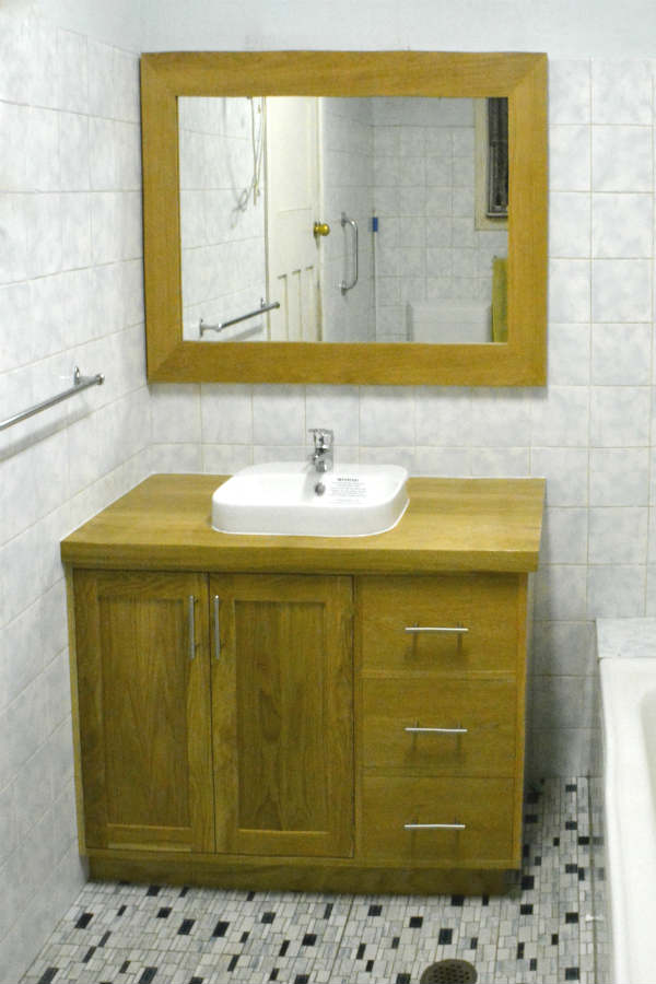 Custom made timber vanity with dovetails draws and construction. Book matched doors. Custom made joinery and cabinet making.