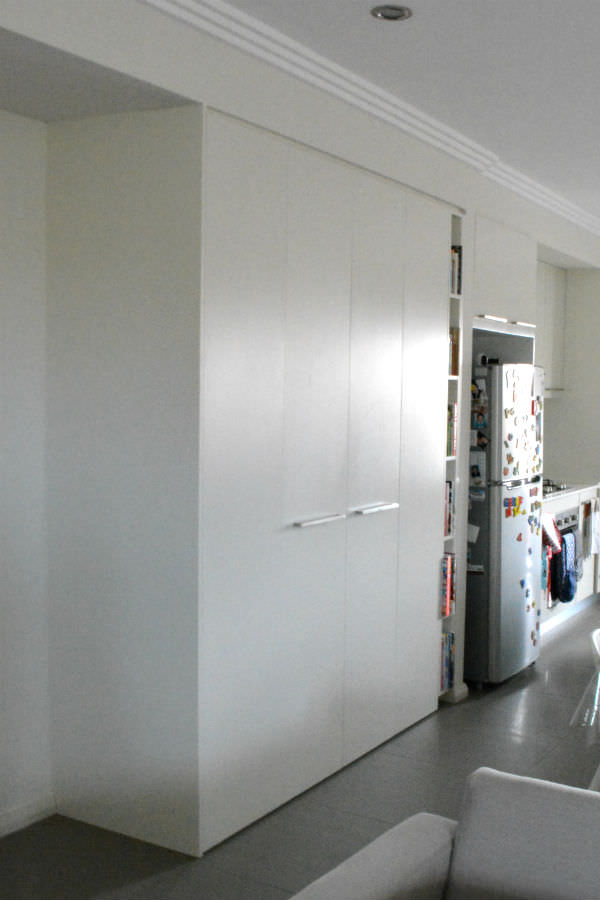 Custom made pantry with by-fold doors. Custom made joinery.