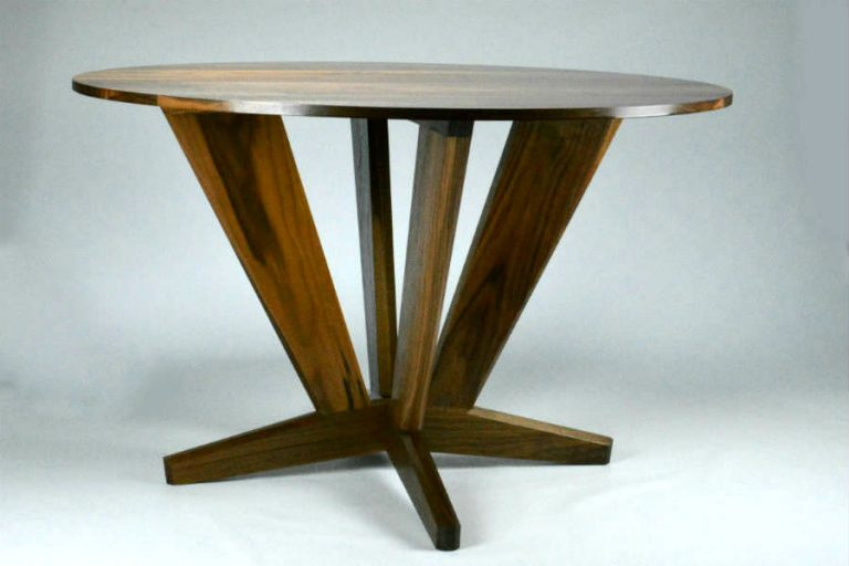 Intersection Round Dining Table. Made from Black Walnut with it's straight lines and angles give it a dynamic solid look for the base. Versatile enough for use as a foyer round or bar table. Custom made timber furniture. Custom made furniture and furniture maker.