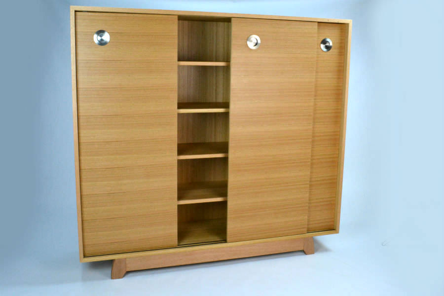 Custom made for a customer to store DVD. Made with sliding doors for easy access. Would be a great addition to any living room or hallway. Custom made timber furniture. Custom made furniture and furniture maker.