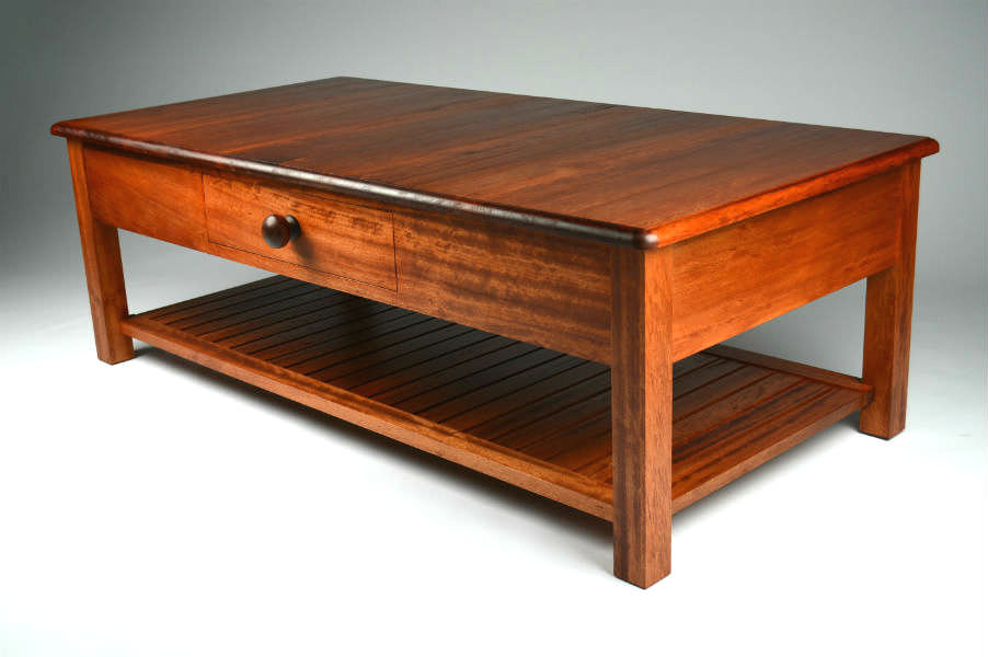 Stained Coachwood Coffee Table. A coffee table commissioned by the Thales Group for a Royal Australian Navy warship. Made in a traditional style and craftsmanship. Custom made timber furniture. Custom made furniture and furniture maker.
