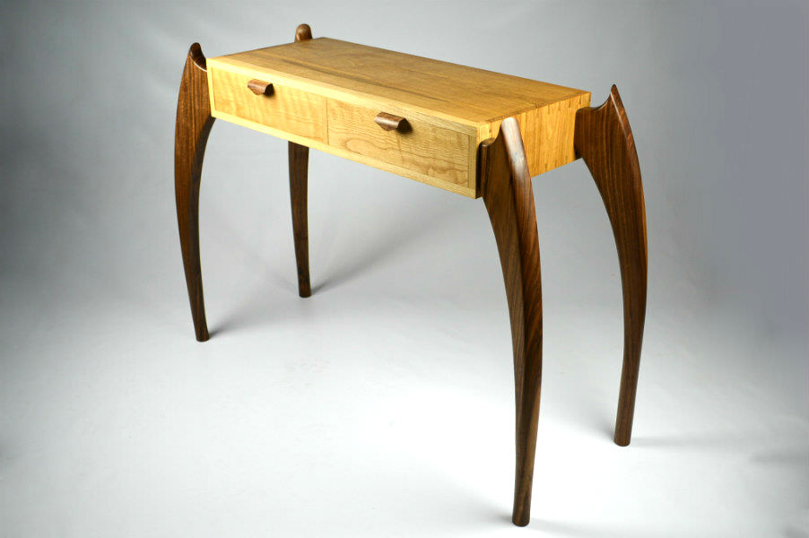 Custom made timber furniture. Custom made furniture and furniture maker. WHITE OAK & BLACK WALNUT CONSOLE TABLE Made from White Oak and Black Walnut featuring our unique leg design for an elegant yet dynamic classic modern look. With hand cut dovetails construction for strength. This versatile design can also be made as a desk.