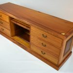 Australian Red Cedar and New Guinea Rosewood Entertainment Cabinet. Made in the traditional style with hand cut hounds dovetails draws. Decorated inlayed motifs and stringing. All solid timber construction with raised panels and secret compartments. Custom made timber furniture. Custom made furniture and furniture maker.