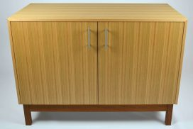 Custom made timber furniture. Custom made furniture and furniture maker. Custom made cabinet made from tassie Oak. With mid century feel and design in this cabinet with the folded veneer that runs around the carcass. Made from Tassie Oak and Australian Red Cedar.