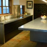 Custom made kitchen With cantilever zinc bench top. Custom made joinery and cabinet making