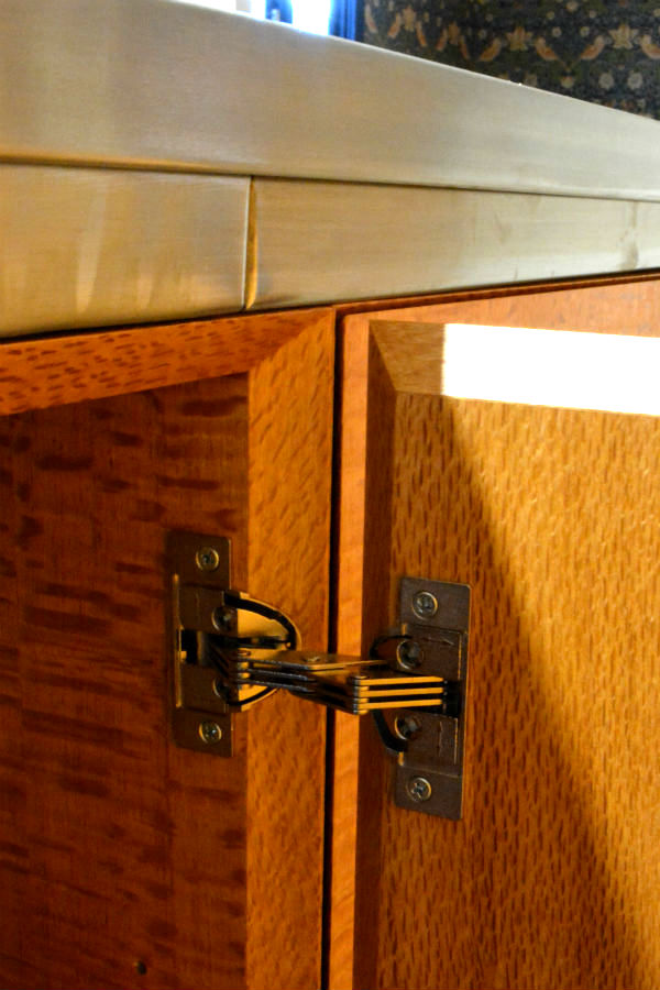 Silky oak doors part of a custom made kitchen. Custom made joinery and cabinet making. With Miter detail doors