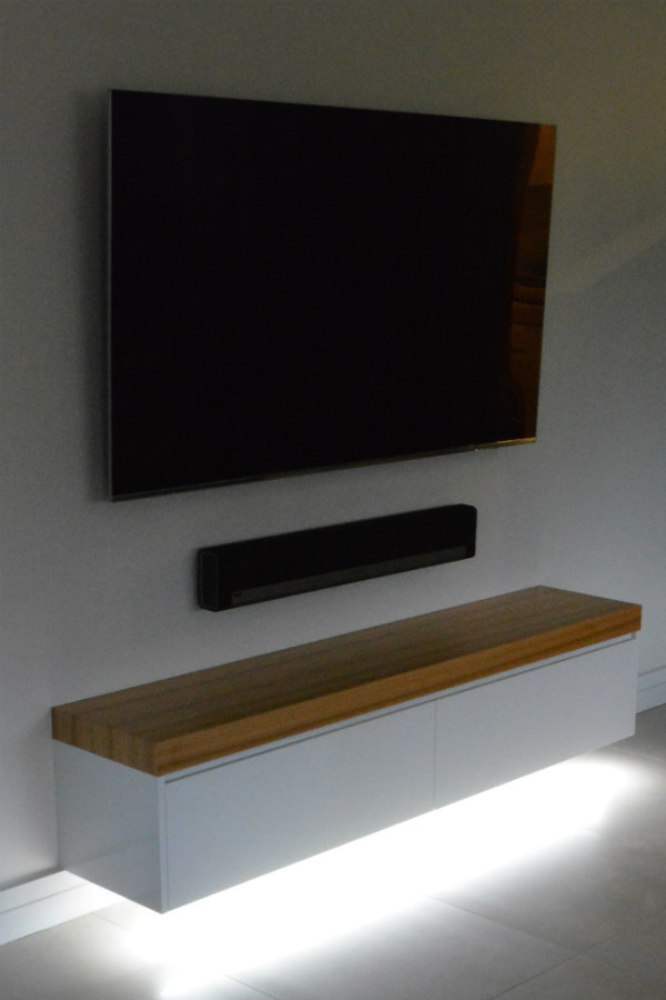 Custom made free floating entertainment unit with black butt top and led down lights. Custom made joinery and cabinet making.