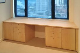 This custom made desk was part of a home office we made for a client in Kent St, Sydney CBD. Made from sycamore veneer with chrome handles to match other joinery that is in client's home. Built to fit with-in the angled walls in this apartment.