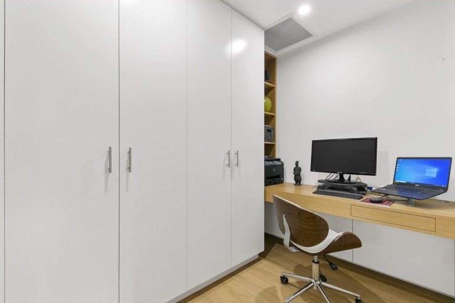 Designed to create a warm inviting atmosphere, this wardrobe and study nook with push touch flush mount draw. Designed to maximize space in a small apartment in Beecroft in a modern contemporary style. Custom made joinery and cabinet making