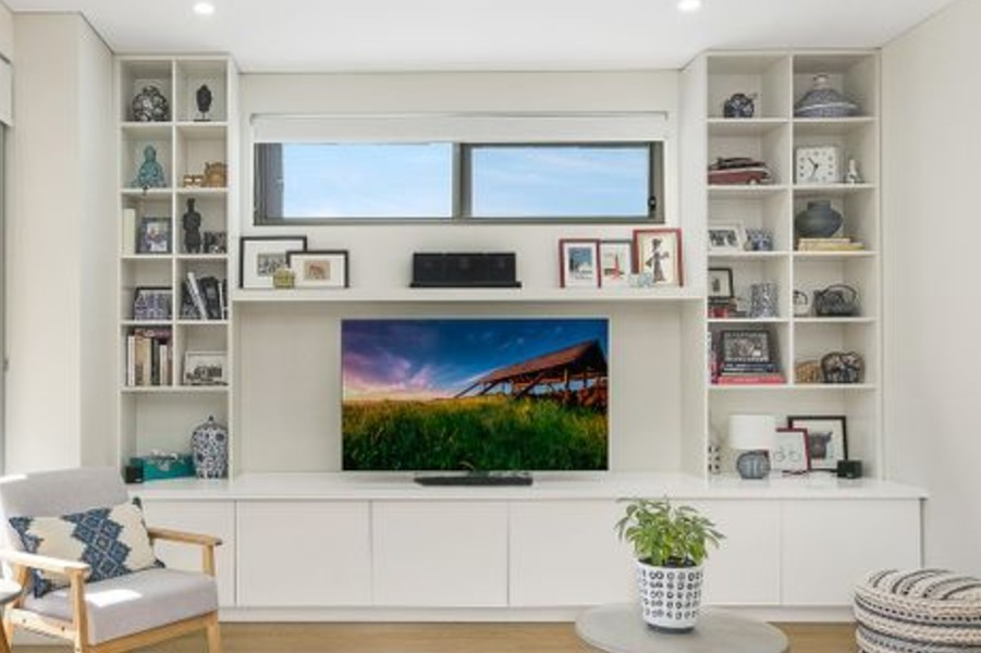 Custom made Entertainment unit with shelf and bookcase each side. Custom made joinery and cabinet making.
