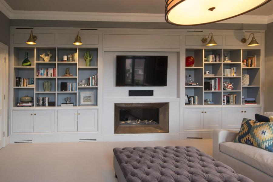 Custom made built-in bookcase and Entertainment unit Kings Cross. Poly painted with built-in speakers and sub. Custom made joinery and cabinet making.