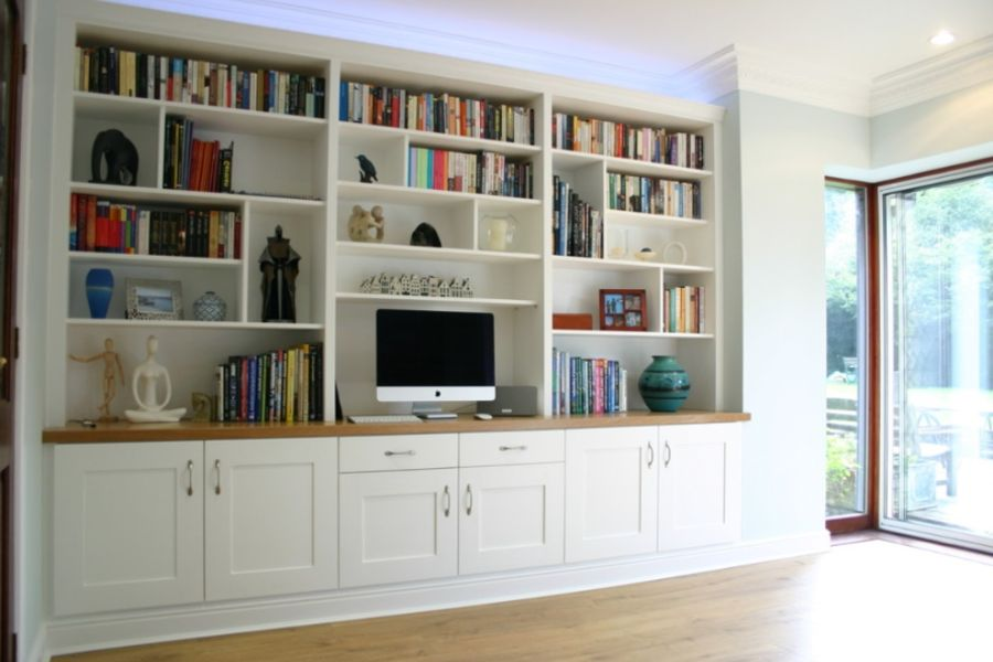 Custom made home office and bookcase. Built-in with shaker style doors and draws with moulding details top and bottom. Custom made cabinet making and joinery.