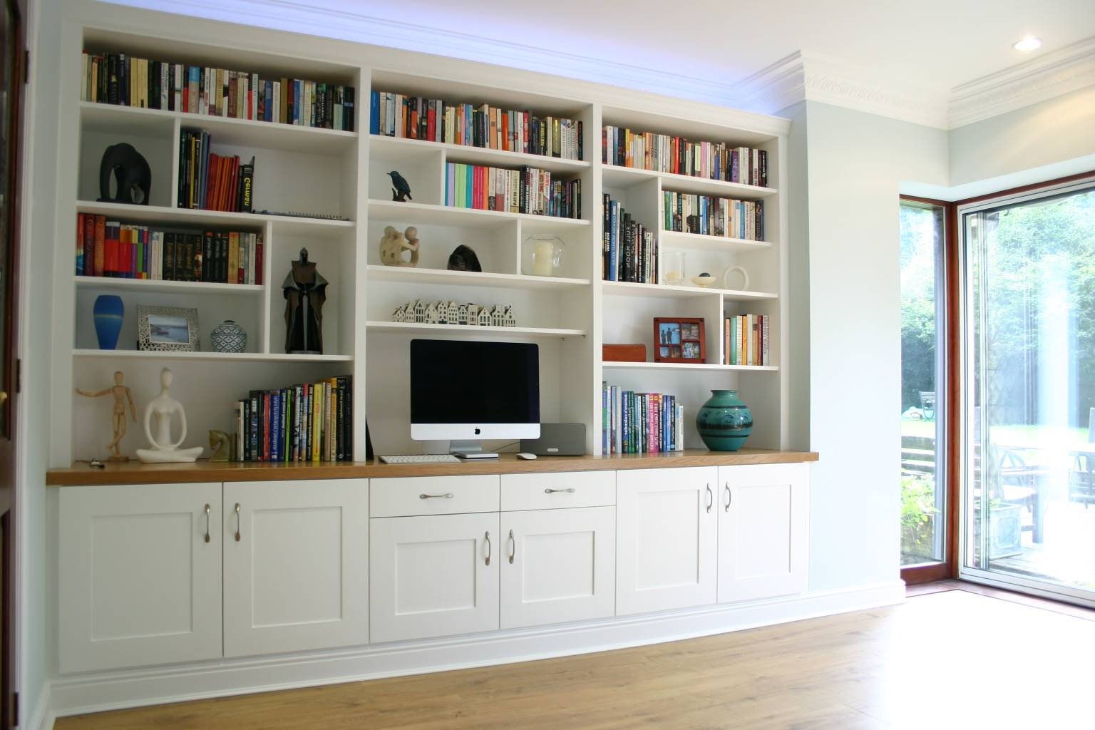 Custom-made built-in home office. With shaker-style doors and soft close Blum hardware. Custom-made timber joinery and cabinet making.
