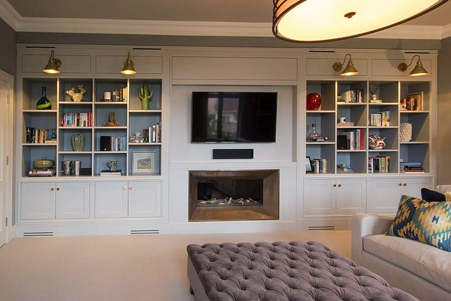 Custom made Entertainment unit Kings Cross. Poly painted with built-in speakers and sub. Custom made joinery and cabinet making.
