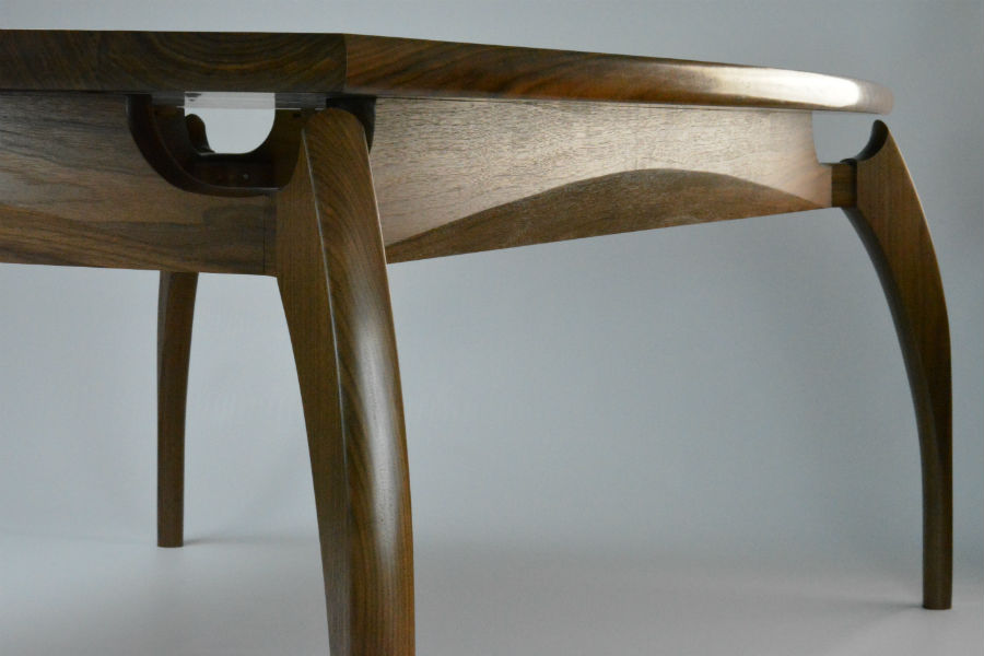 WALNUT DINING TABLE Made from black walnut featuring our unique leg design, clean lines, signature bevels and curved facets for that something special. It can also be made as a round or rectangle dining table as well. Custom made timber furniture and bespoke furniture in Sydney