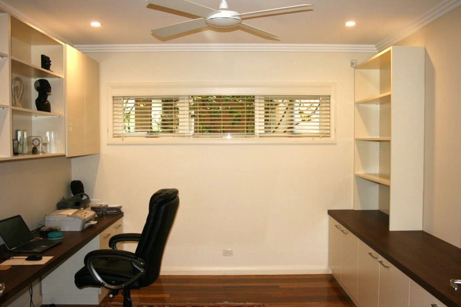 This two-seater home office with built-in bookcases was built for a customer in Pymble with shaker-style doors and timber walnut benchtop. Finished in satin white ploy paint with clear satin on the benchtop using Blum hinges and draw runner.